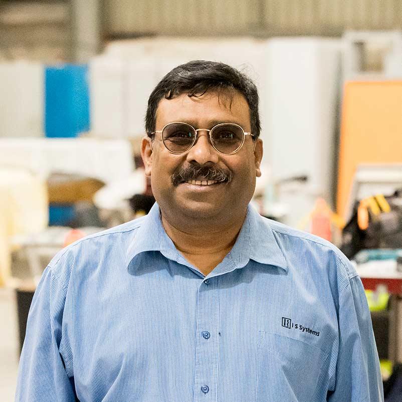 Niel Mukherjee, smiling in our workshop